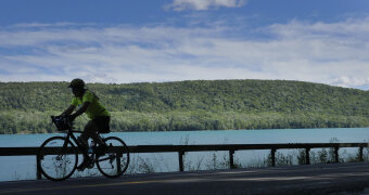 Cyclist along side coast Cooperstown Bike Tour