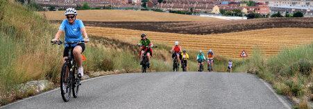 Cyclist on road Spain Camino de Santiago bike tour