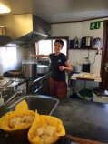 Preparing food during Italy Bike and Barge Bike Tour