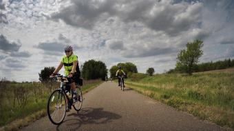 two cyclist on bike path Minnesota Lake Wobegon Trail Bike Tour