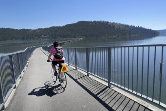 Cyclist on bridge bike path Idaho Greenways Bike Tour