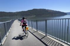 Cyclist on bridge bike path Idaho Greenways Bike Tour