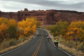 Cliff and bike path view Moab Arches and Canyonlands Bike Tour