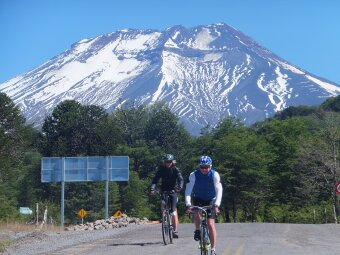 Two cyclists in Chile below Lonquimay Volcano