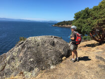 Cyclist enjoying the view Washington San Juan Islands Bike Tour