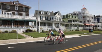 Suburban view and cyclist during Jersey Shore Bike Tour