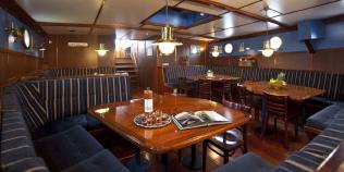 Dining room on the Wapen fan Fryslân sailboat in the Netherlands
