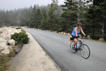 Cyclist on bike path during Maine Acadia National Park Bike Tour
