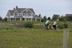Cyclist along bike path Massachusetts Island Hopper Bike Tour