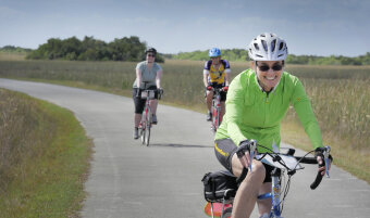 Three cyclist on the bike path during Florida Everglades and the Keys Bike Tour