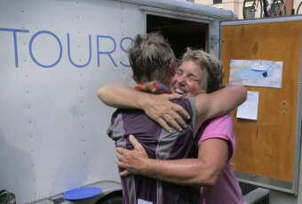 2 Cyclist hugging at the end of Epic Bike Tour