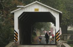 Cyclist going through tunnel Pennsylvania Dutch Country Bike Tour