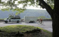 Woman tours van and cyclist Epic Bike Tour