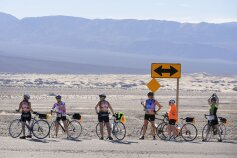 Cyclist enjoying gate desert view Death Valley Bike Tour
