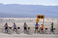 Cyclist enjoying gate desert view Death Valley Bike Tour
