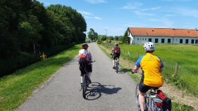 Cyclist along a pathway during Holland Bike and Barge Meandering the Meuse Bike Tour