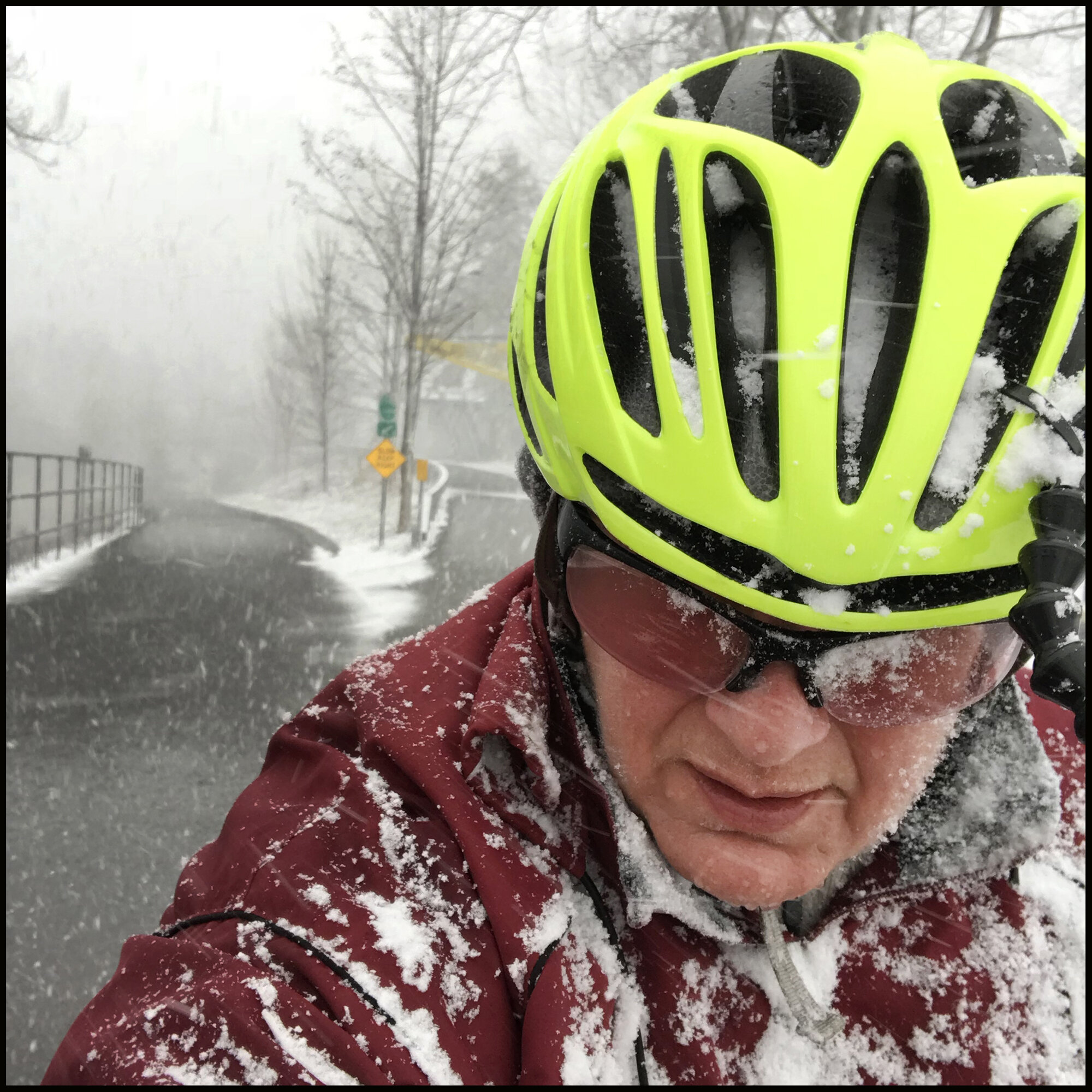 Selfie of Annette cycling in the snow.