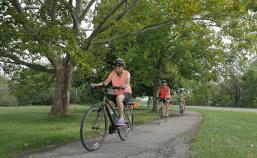 Cyclist along bike path Niagara Falls Pathways