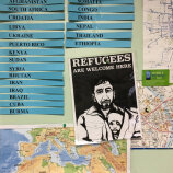 Bulletin board with names and refugees sign R Community Bikes