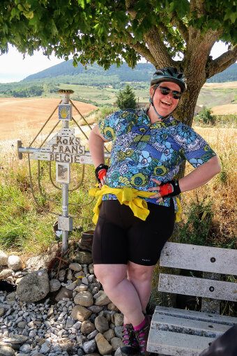 Cyclist leaning on a tress posing for a photo Spain Camino de Santiago bike tour