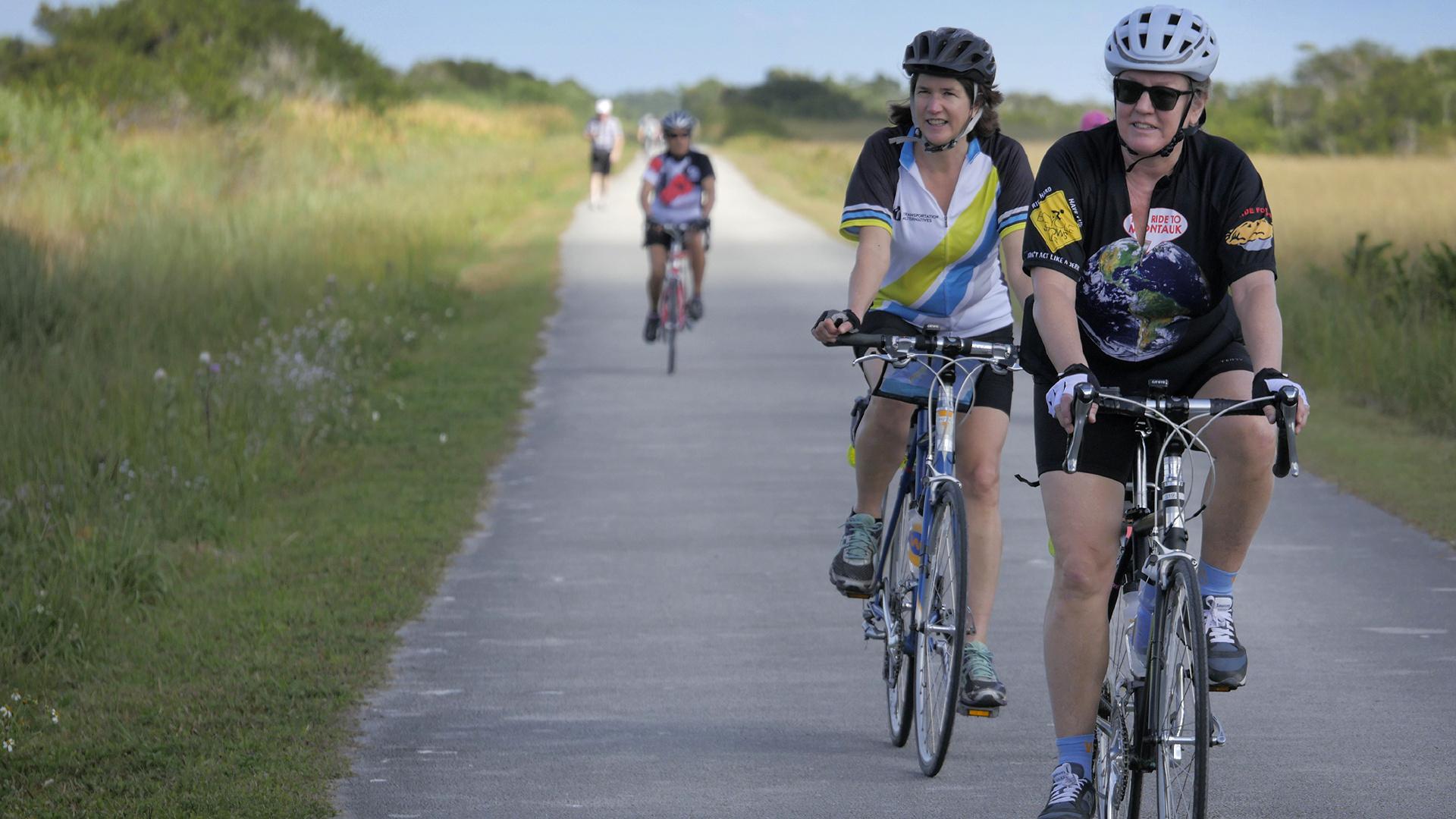 Cyclists ride the bike path to the Florida Keys