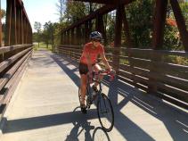 Cyclist riding on bridge Erie Canal Bike Tour