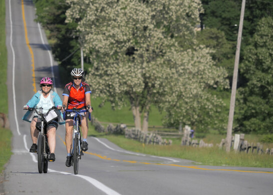Gerri rides an ebike next to Jackie.
