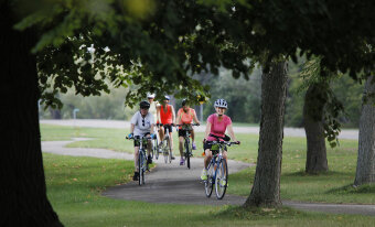 Cyclist on bike path during Niagara Falls Pathways