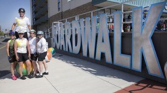 Cyclist pose for photo on boardwalk Jersey Shore Bike Tour