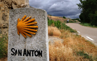 rock and a shell sign Spain Camino de Santiago bike tour
