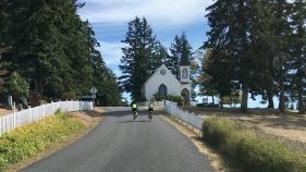 Cyclist on bike road Washington San Juan Islands Bike Tour