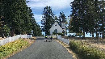 Cyclist on bike road Washington San Juan Islands Bike Tour
