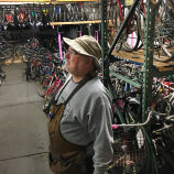 Admiring all the bikes in storage R Community Bikes