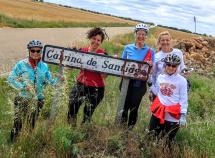 Cyclist holding up sign and posing for camera Spain Camino de Santiago bike tour