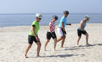 4 cyclist enjoying the beach on Jersey Shore Bike Tour