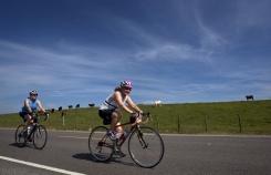 Two cyclist riding along side farm during Louisiana Bike Tour